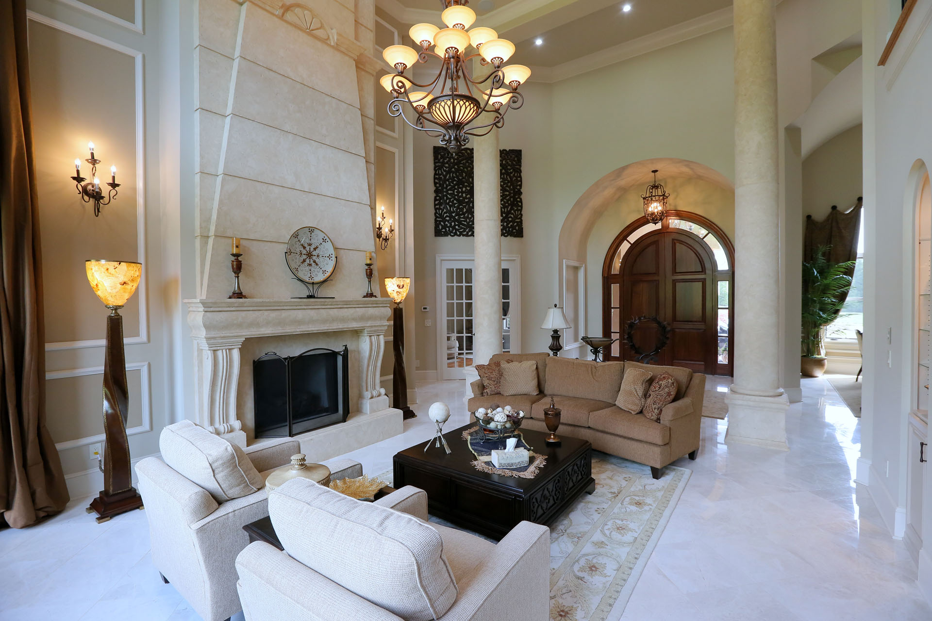 Beautiful Living Room with Classic cast stone fireplace mantel