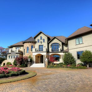 grand custom cast stone front entry on beautiful estate