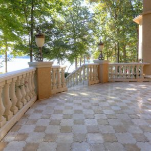 cast concrete pavers and stone balusters