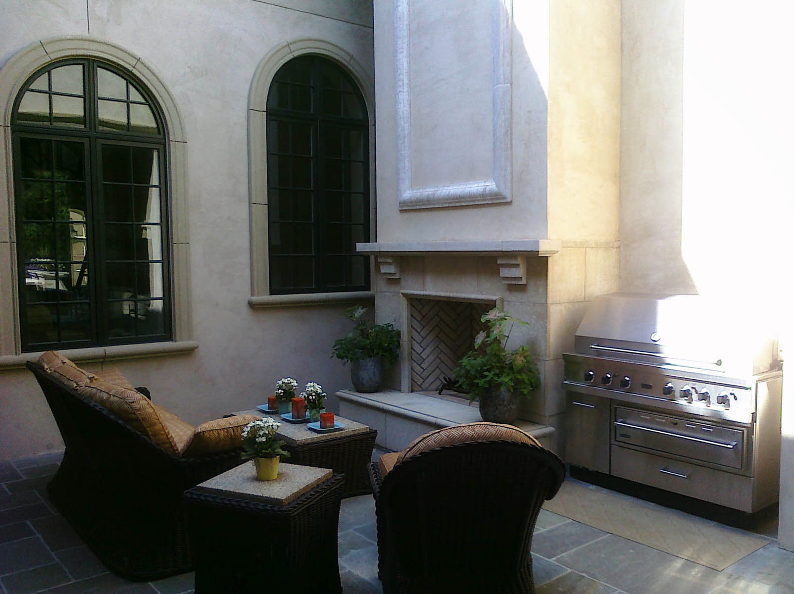 exterior cast stone fireplace area with grill