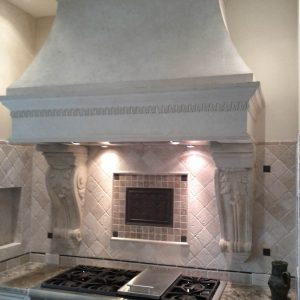Provincial cast stone range hood with custom corbels