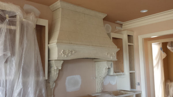 Custom Vermont with Laurel Corbels Stone Range hood